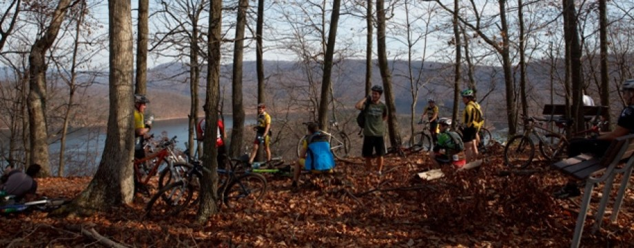 Mountain bikers resting at the overlook on the Allegrippis Trails at Raystown Lake by Abram Eric Landes