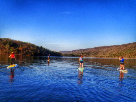 Bobbi and a group of friends enjoy an evening of paddleboarding on Raystown Lake. Photo by Helena Kotala.
